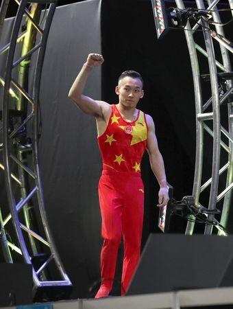Oct 3, 2017; Montreal, Quebec, CAN; Ruoteng Xiao of People's Republic of China waves to the crowd as he finishes first at the Men's Individual All-Around Final during the 47th FIG Artistic Gymnastics World Championship at Montreal Olympic Stadium. Mandatory Credit: Jean-Yves Ahern-USA TODAY Sports