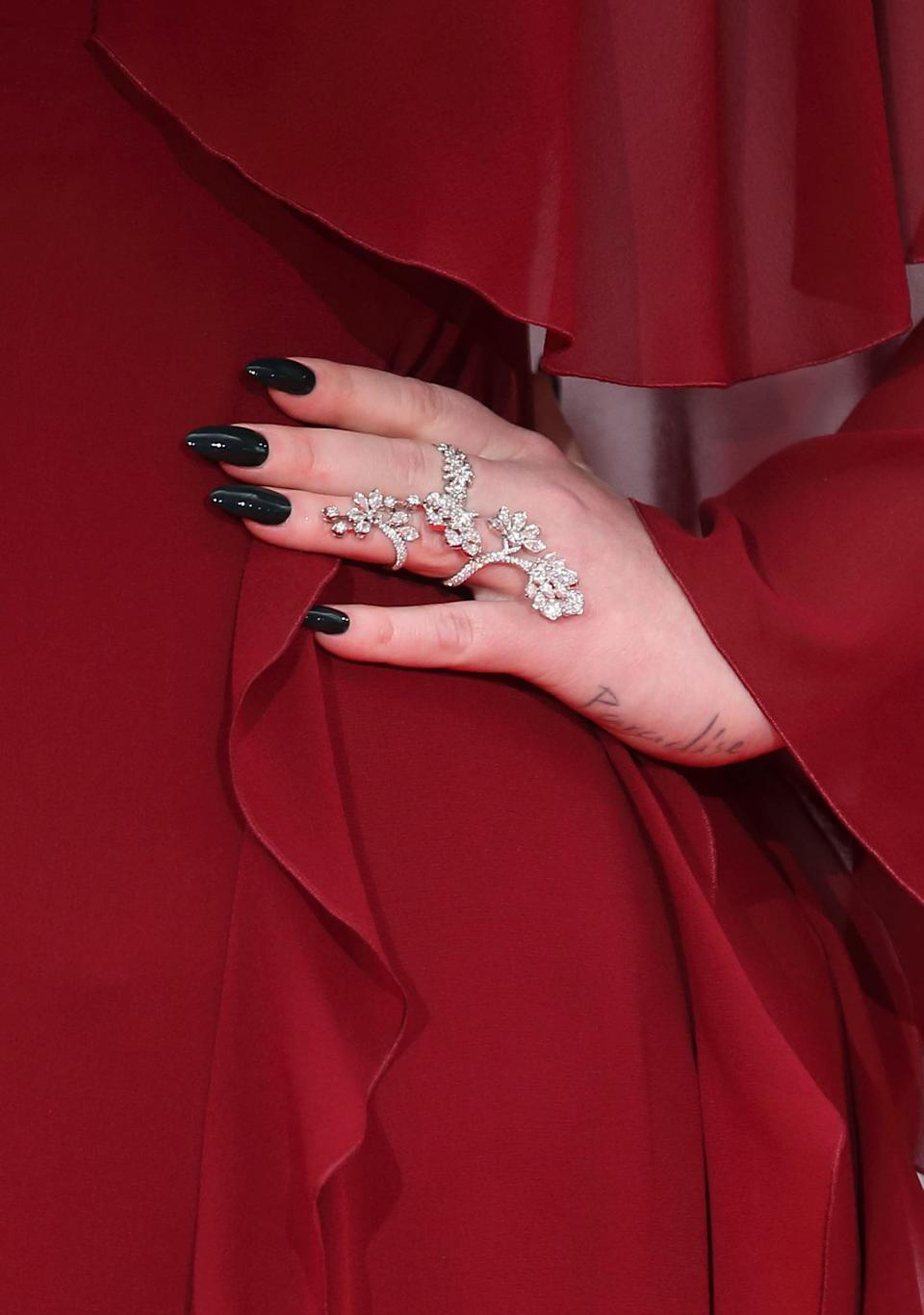 """<p>On her left hand, Adele has a tattoo of the word, """"paradise."""" She has not revealed the meaning behind the tattoo.</p>"""