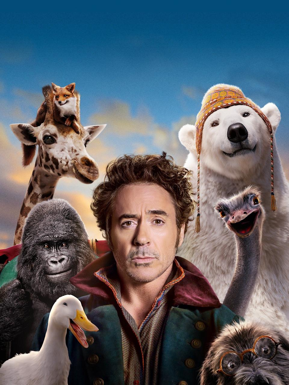 Robert Downey Jr. as Dr. John Dolittle, and the animals in Dolittle.