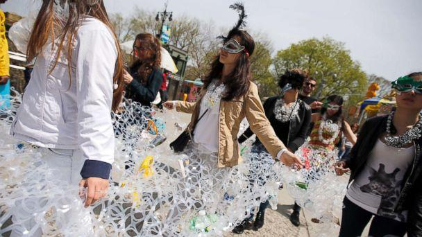 PHOTO: Demonstrators march together in plastic six pack rings during a demonstration to mark Earth Day in Manhattan, April 22, 2014, in this file photo in New York City. (Mike Segar/Reuters, FILE)