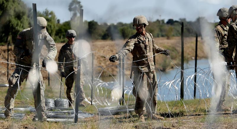 Members of the U.S. military install concertina wire along the banks of the Rio Grande at the U.S.-Mexico border in Laredo, Texas, on Nov. 16, 2018. (Eric Gay/AP)