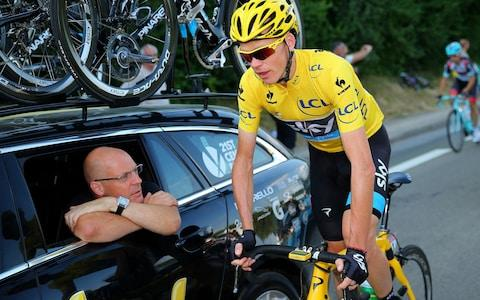 Dave Brailsford speaks with the winner of the 2013 Tour de France, Chris Froome  - Credit: Getty Images