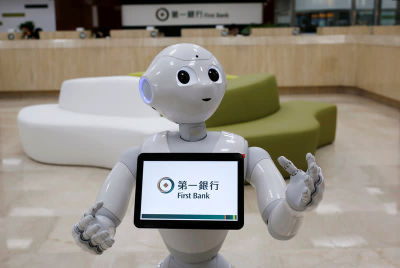 FILE PHOTO: FILE PHOTO: SoftBank's robot 'Pepper', is seen at First Bank branch as a concierge to welcome customers in Taipei, Taiwan