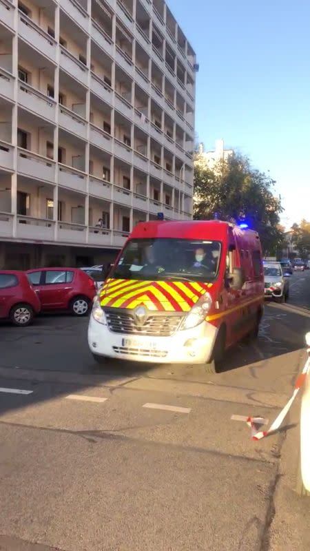 An ambulance is seen at the scene where an Orthodox priest was shot and injured as the assailant fled, as police source claims, in Lyon