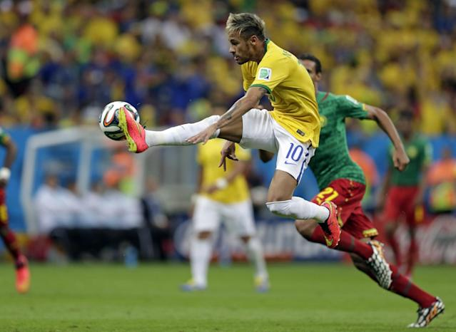 Brazil's Neymar controls a ball during the group A World Cup soccer match between Cameroon and Brazil at the Estadio Nacional in Brasilia, Brazil, Monday, June 23, 2014. (AP Photo/Dolores Ochoa)