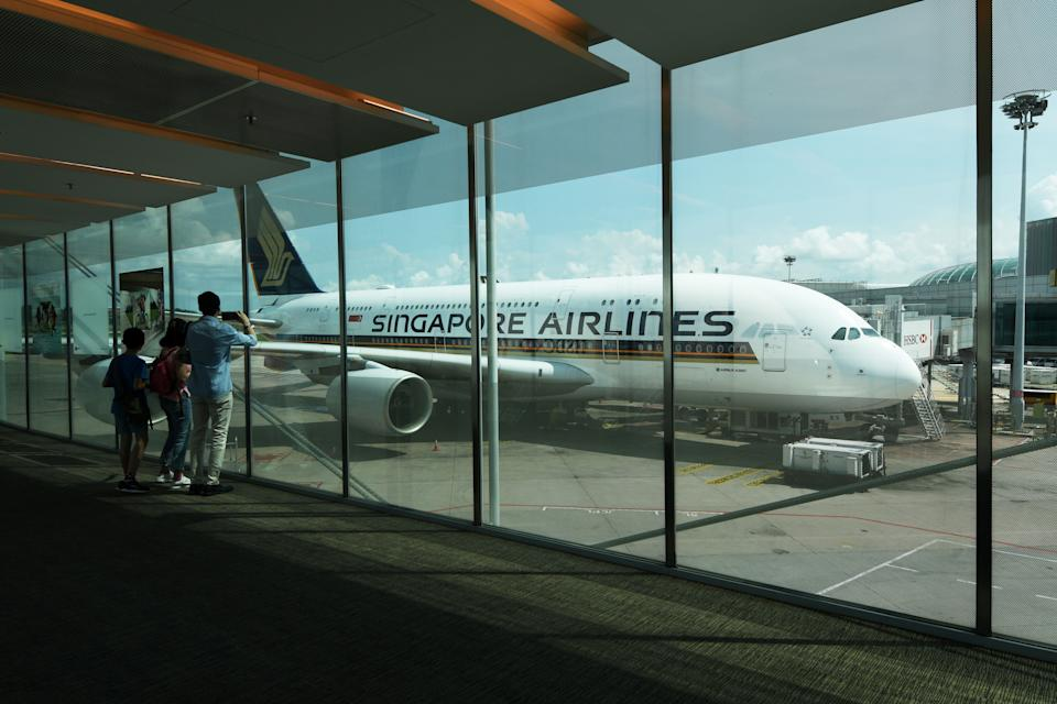 SINGAPORE, Nov. 1, 2020 -- A Singapore Airlines A380 aircraft is seen at Singapore's Changi Airport Terminal 3 on Oct. 31, 2020. Over two weekends from Oct. 24 to Nov. 1, Singapore Airlines hosted diners in two A380 passenger aircraft docked in Changi Airport Terminal 3, offering customers a chance to have meals in an aircraft setting. (Photo by Then Chih Wey/Xinhua via Getty) (Xinhua/Then Chih Wey via Getty Images)