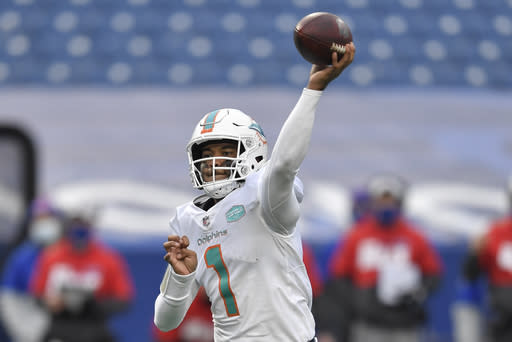 Miami Dolphins quarterback Tua Tagovailoa (1) passes in the second half of an NFL football game against the Buffalo Bills, Sunday, Jan. 3, 2021, in Orchard Park, N.Y. (AP Photo/Adrian Kraus)