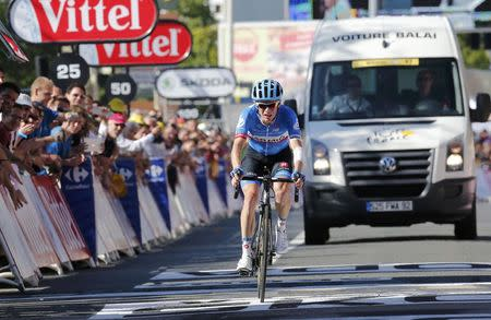 Garmin-Sharp team rider Andrew Talansky of the U.S.A cycles to cross the finish line of the 187.5-km 11th stage of the Tour de France cycling race between Besancon and Oyonnax, July 16, 2014. REUTERS/Jean-Paul Pelissier