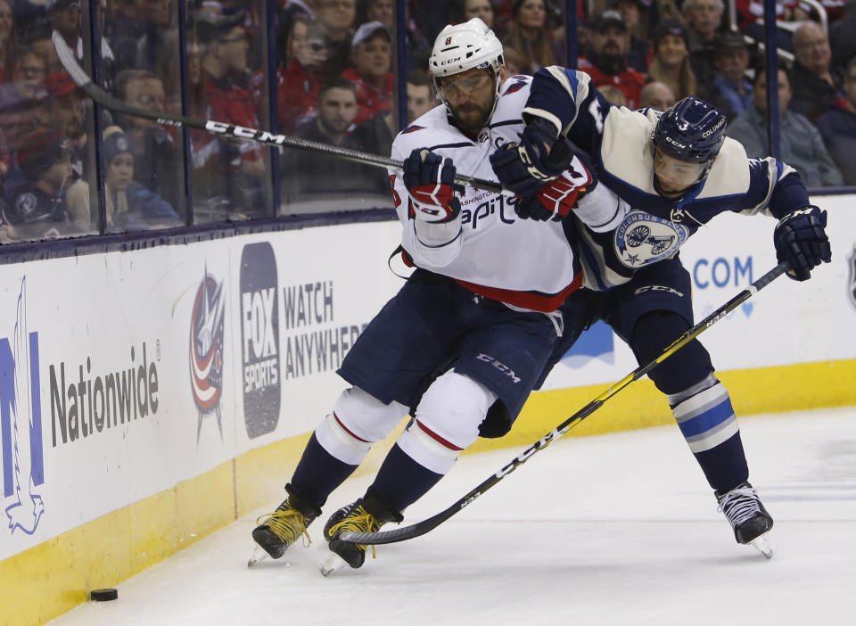 Washington Capitals' Alex Ovechkin, left, of Russia, and Columbus Blue Jackets' Seth Jones chase a loose puck during the first period of an NHL hockey game Tuesday, Feb. 12, 2019, in Columbus, Ohio. (AP Photo/Jay LaPrete)