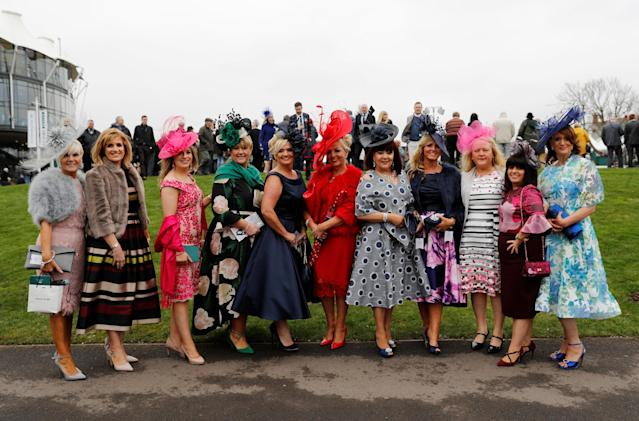Horse Racing - Grand National Festival - Aintree Racecourse, Liverpool, Britain - April 12, 2018 Racegoers pose for a photo at the Grand National Festival REUTERS/Darren Staples