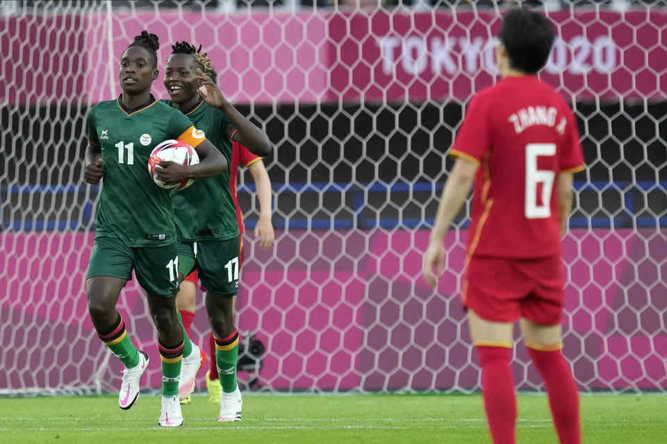 Zambia's Babra Banda (11) celebrates after scoring a goal against China during a women's soccer match at the 2020 Summer Olympics, Saturday, July 24, 2021, in Miyagi, Japan. (AP Photo/Andre Penner)