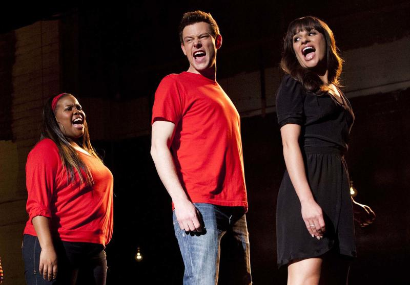 """In this undated image released by Fox, cast members, from left, Amber Riley, Cory Monteith and Lea Michele perform during a scene from """"Glee."""" Fox says Cory Monteith's addiction-related death will be addressed in the """"Glee"""" episode bidding farewell to his character, Finn Hudson. Fox Entertainment Chairman Kevin Reilly declined Thursday to specify how the character of Finn would exit, saying he couldn't confirm Finn would be felled by drugs. The 31-year-old Monteith was found dead in a hotel room in Canada last month. Tests showed his death was caused by a mixture of heroin and alcohol. (AP Photo/Fox, Adam Rose, File)"""