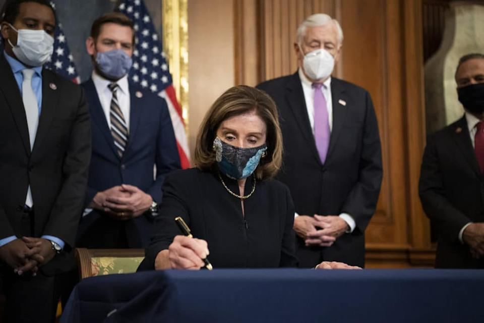 Speaker of the House Nancy PelosI, signs an Article of Impeachment during an engrossment ceremony in the Capitol. (Caroline Brehman/CQ-Roll Call, Inc via Getty Images)
