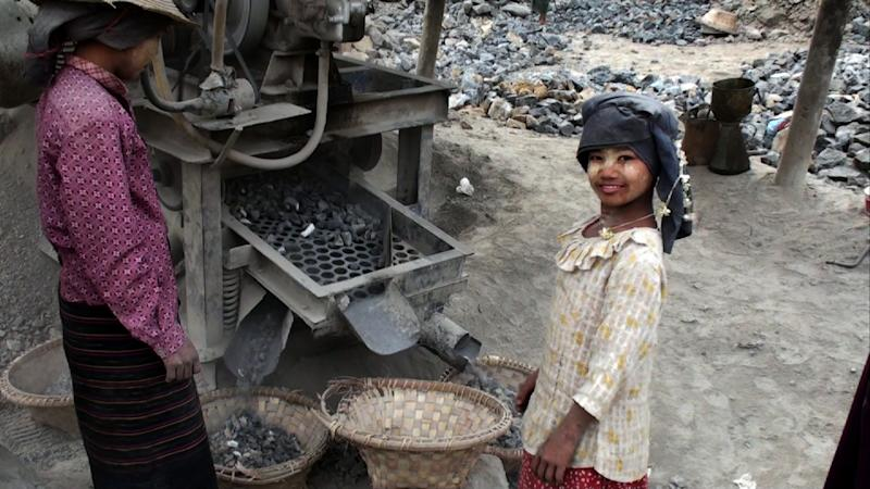 """This screen grab provided by Robert Lieberman shows a girl in a rock quarry in Myanmar. Lieberman went to Myanmar to train local filmmakers and shot his own documentary on the sly. The solo-filmed """"They Call It Myanmar: Lifting the Curtain,"""" pries the lid off daily life in what has long been one of world's most isolated and repressed places, examining its grinding poverty and tragic decades of military rule. The film is a reminder that, despite recent upbeat news as Myanmar ventures on a reform path that has seen releases of political prisoners and easing of censorship, it remains a country with huge problems. The movie is showing at selected theaters in the United States. (AP Photo/Robert Lieberman"""