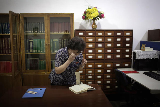 <p>A staff member at the Grand People's Study House looks for a specific publication on July 24, 2017, in Pyongyang, North Korea. The building is situated on Kim Il Sung Square and serves as the central library where North Koreans also go to for language classes such as English, Chinese German and Japanese. (Photo: Wong Maye-E/AP) </p>