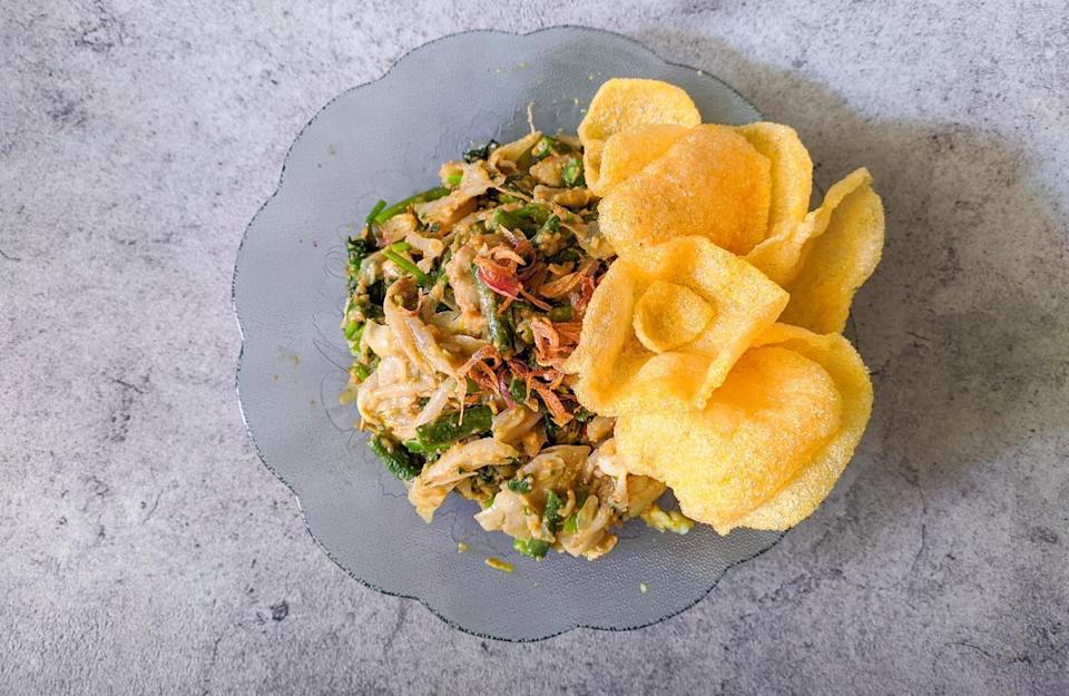 """<p>A beloved Indonesian dish, Gado Gado is made by slightly cooking green beans, cauliflower, cabbage and spinach and marinating them in peanut sauce. Serve the salad with crackers or rice.</p> <p><a href=""""https://www.thedailymeal.com/recipes/vegetable-salad-peanut-sauce-gado-gado-recipe?referrer=yahoo&category=beauty_food&include_utm=1&utm_medium=referral&utm_source=yahoo&utm_campaign=feed"""" rel=""""nofollow noopener"""" target=""""_blank"""" data-ylk=""""slk:For the Vegetable Salad With Peanut Sauce (Gado Gado) recipe, click here."""" class=""""link rapid-noclick-resp"""">For the Vegetable Salad With Peanut Sauce (Gado Gado) recipe, click here.</a></p>"""