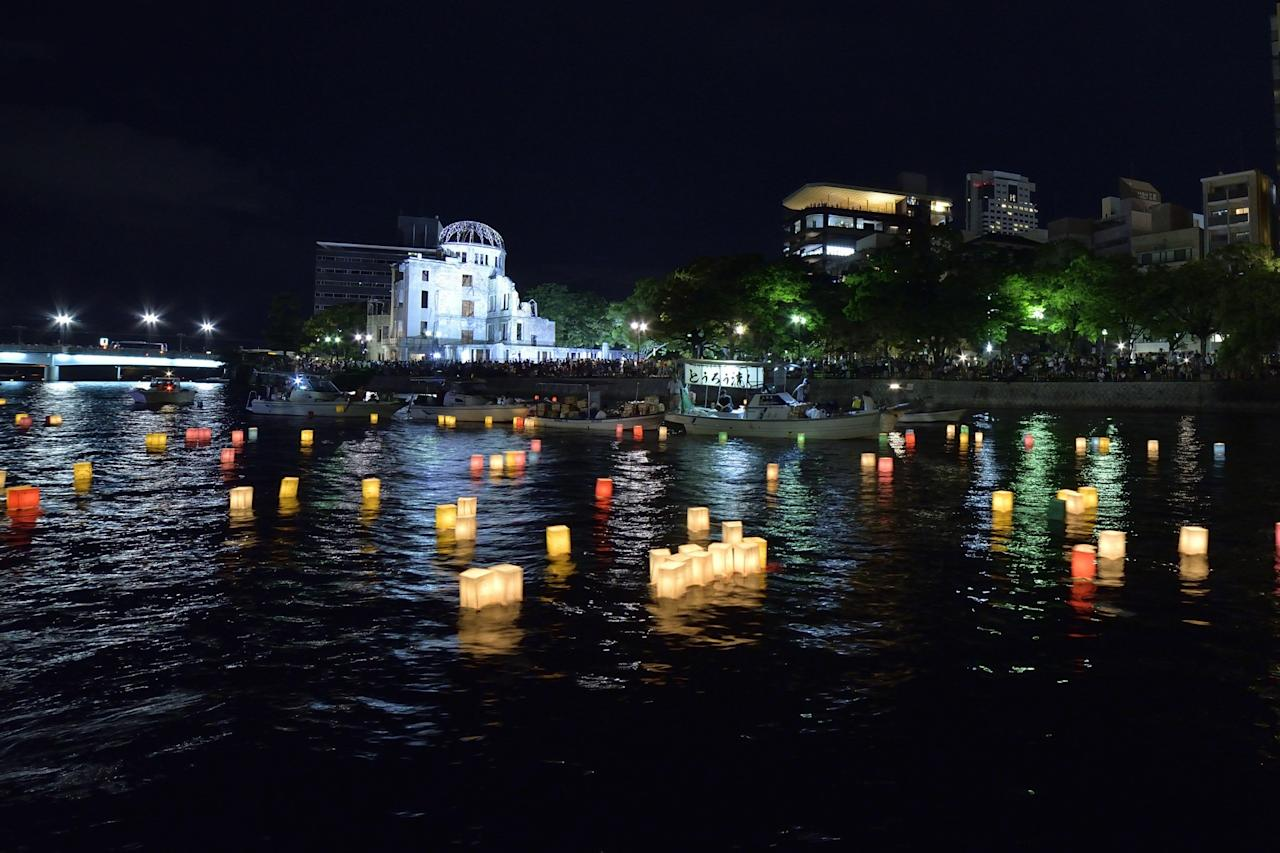 <p>People attend the Peace Message Lantern Floating Ceremony held to console the souls of the A-Bomb victims after the Hiroshima Peace Memorial Ceremony at the Hiroshima Peace Memorial Park on the occasion of the 72nd anniversary of Hiroshima atomic bombing on Aug. 6, 2017 in Hiroshima, Japan. (Photo: David Mareuil/Anadolu Agency/Getty Images) </p>