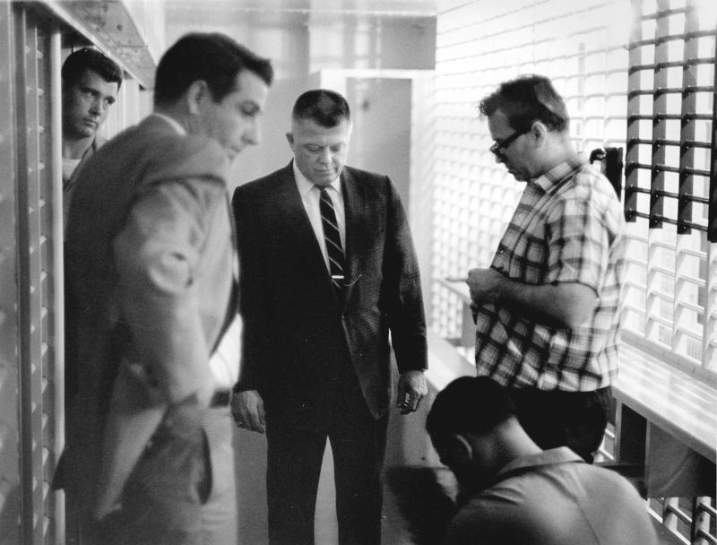In this 1968 photo released Wednesday, March 30, 2011 by the Shelby County Register's office, Sheriff William N. Morris Jr., second from left, and deputies process James Earl Ray, at right, in the Shelby County, Memphis, Tenn. Long forgotten photos documenting the incarceration of James Earl Ray after his arrest for the assassination of Martin Luther King Jr. will be posted online asearly as Wednesday afternoon to commemorate the 43rd anniversary of the civil rights leader's death. (AP Photo/Shelby County Register's office)