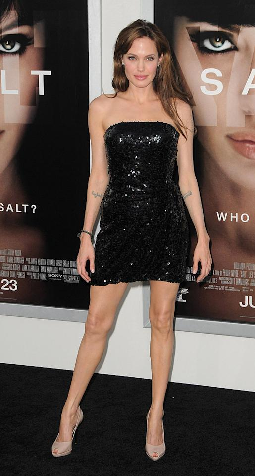 """15. <a href=""""http://movies.yahoo.com/movie/1810072508/info"""">Salt</a> LA premiere (2010)   At the Monday night premiere of her new spy flick, Angelina wowed the crowd in a sequined Emporio Armani strapless mini, sexy Salvatore Ferragamo heels, and a simple yet chic Asprey bracelet."""