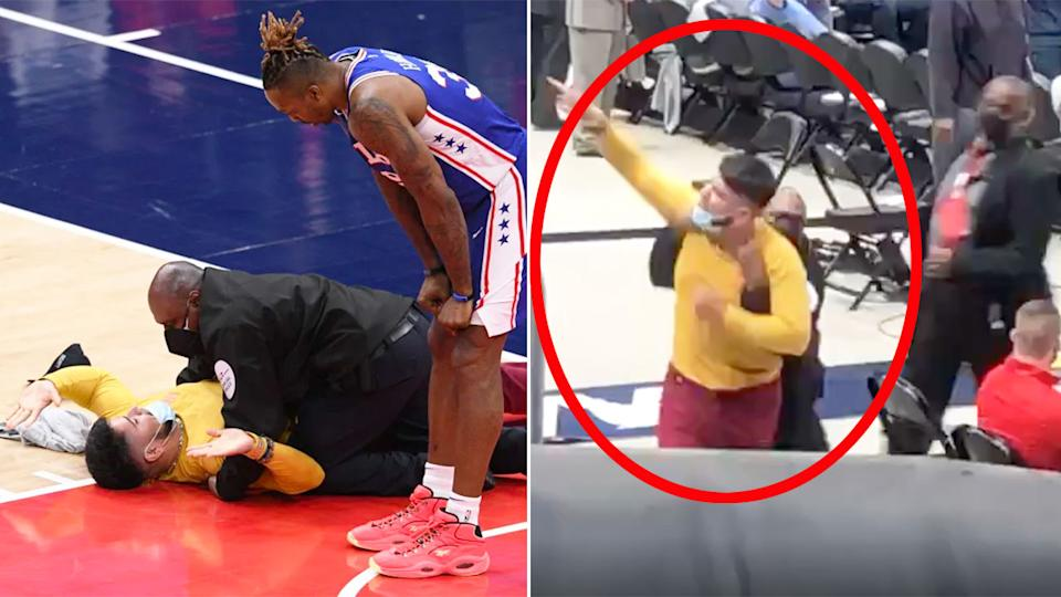 An NBA fan was escorted out of the arena after running onto the court during the Playoffs game. Pic: AP/TNT
