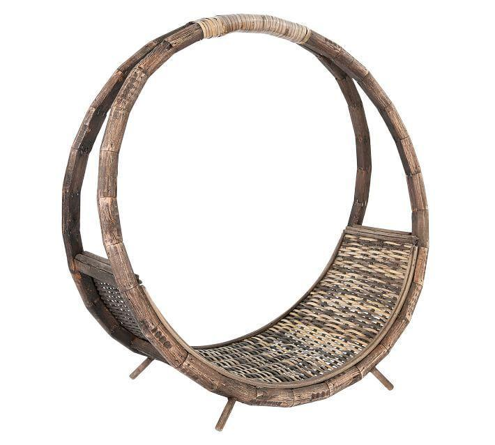 """<p>potterybarn.com</p><p><strong>$79.00</strong></p><p><a href=""""https://go.redirectingat.com?id=74968X1596630&url=https%3A%2F%2Fwww.potterybarn.com%2Fproducts%2Frattan-log-holder-mp&sref=https%3A%2F%2Fwww.thepioneerwoman.com%2Fhome-lifestyle%2Fdecorating-ideas%2Fg35001978%2Fblanket-storage-ideas%2F"""" rel=""""nofollow noopener"""" target=""""_blank"""" data-ylk=""""slk:Shop Now"""" class=""""link rapid-noclick-resp"""">Shop Now</a></p><p>Forget logs: Roll up blankets tight and stack them in this holder. You can still leave it right by the fireplace for extra coziness on cold winter nights!</p>"""