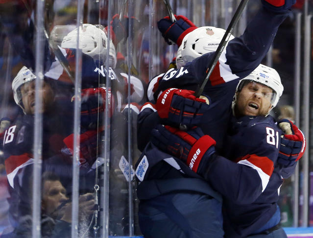 Team USA celebrates a second period goal against Russia during a men's ice hockey game at the 2014 Winter Olympics, Saturday, Feb. 15, 2014, in Sochi, Russia. (AP Photo/Mark Humphrey)
