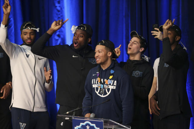 "Teammates chant ""one more year"" as Villanova's Jalen Brunson, center, is introduced during a celebration of the team's NCAA men's basketball tournament championship, at Jake Nevin Field House on Tuesday, April 3, 2018, in Villanova, Pa. (Tim Tai/The Philadelphia Inquirer via AP)"