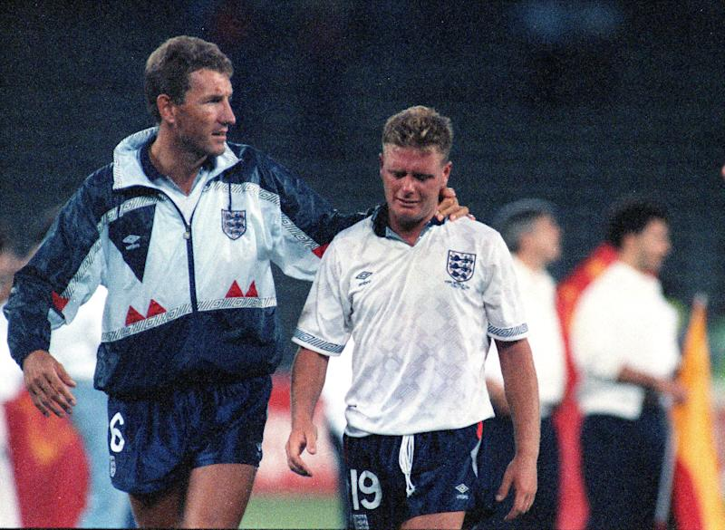 England's Paul Gascoigne cries as he is escorted off the field by team captain Terry Butcher, after his England lost a penalty shoot-out in the semi-final match of the World Cup against West Germany, July 4, 1990, in Turin, Italy. (AP Photo/Roberto Pfeil)