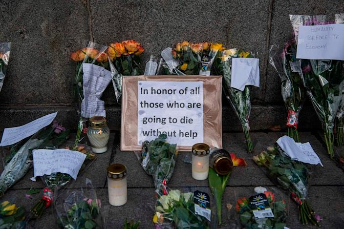 A sign at a memorial in Stockholm's Mynttorget square expresses frustration over Sweden's softer approach to containing the coronavirus.