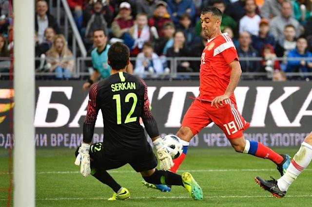 Russia's Alexander Samedov shoots to score the opening goal during an international friendly against Turkey (AFP Photo/Alexander NEMENOV)