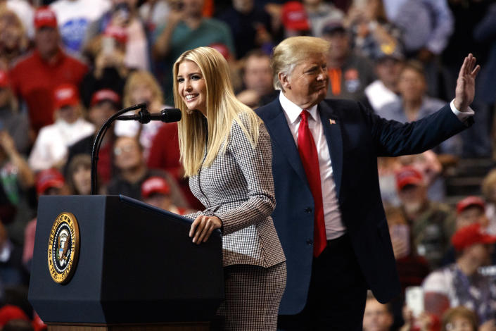 President Donald Trump stands on stage with his daughter Ivanka Trump as she speaks during a campaign rally at the IX Center, in Cleveland, Monday, Nov. 5, 2018, (AP Photo/Carolyn Kaster)
