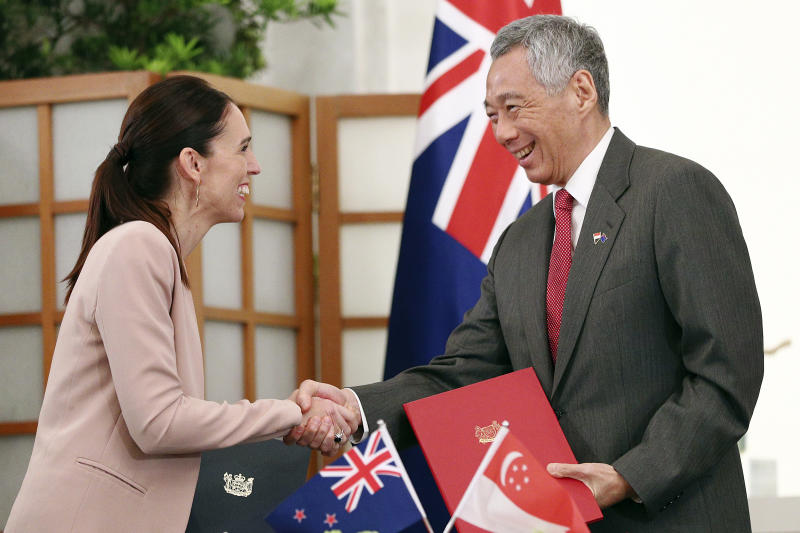 New Zealand's Prime Minister Jacinda Ardern, left, shakes hands with Singapore's Prime Minister Lee Hsien Loong after signing a joint declaration for enhanced partnership at the Istana or presidential palace in Singapore, Friday, May 17, 2019. (AP Photo/Yong Teck Lim)