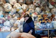 "Valeria Schmidt, nicknamed as ""Teddy Bear Mama"", hugs a teddy bear in Harsany"