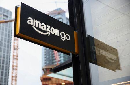 A sign for the new Amazon Go store on 7th Avenue at Amazon's Seattle headquarters in Seattle, Washington, U.S., January 29, 2018.   REUTERS/Lindsey Wasson