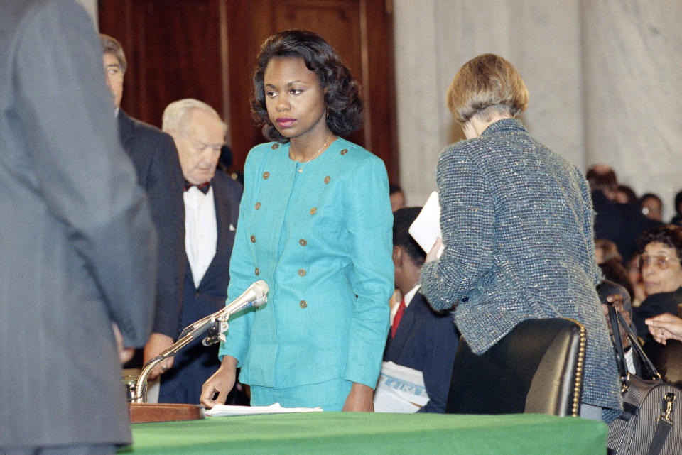 """FILE - In this Oct. 11, 1991 file photo, University of Oklahoma law professor Anita Hill stands in the Caucus Room after spending the morning testifying before the Senate Judiciary Committee on Capitol Hill in Washington. """"Uncertainty: that's the thing that keeps people from coming forward,"""" says Hill, who famously came forward herself in 1991 with harassment allegations against Clarence Thomas in his Supreme Court confirmation hearing. """"They just don't know what's going to happen. And you do know it's going to be really brutal."""" (AP Photo/Greg Gibson, File)"""