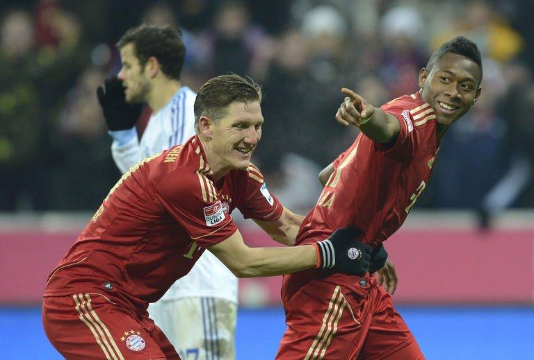 Bayern Munich's Bastian Schweinsteiger (L) and David Alaba celebrate in Munich, southern Germany, on February 9, 2013