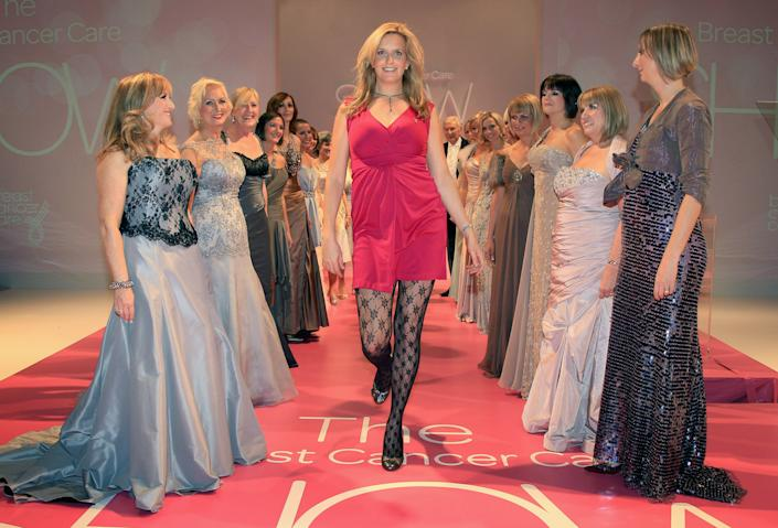 LONDON, ENGLAND - OCTOBER 06:  Model and photographer Penny Lancaster poses with models in the Breast Cancer Care Fashion Show at the Dorchester on October 6, 2010 in London, England. All 24 models (including one man) in the show have had breast cancer and are taking to the catwalk for the first time. (Photo by Chris Jackson/Getty Images for Breast Cancer Care)