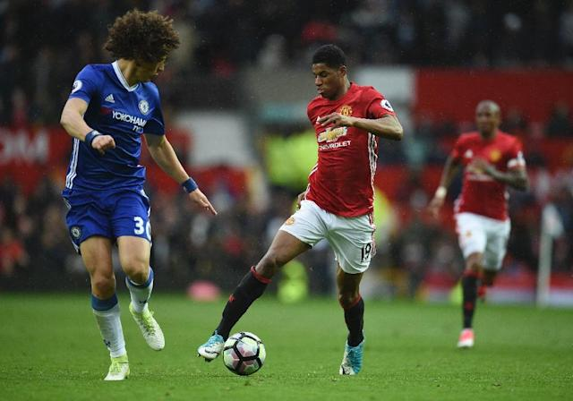 Manchester United's striker Marcus Rashford (R) takes on Chelsea's defender David Luiz (L) during the English Premier League football match between Manchester United and Chelsea at Old Trafford in Manchester, north west England, on April 16, 2017 (AFP Photo/Oli SCARFF )