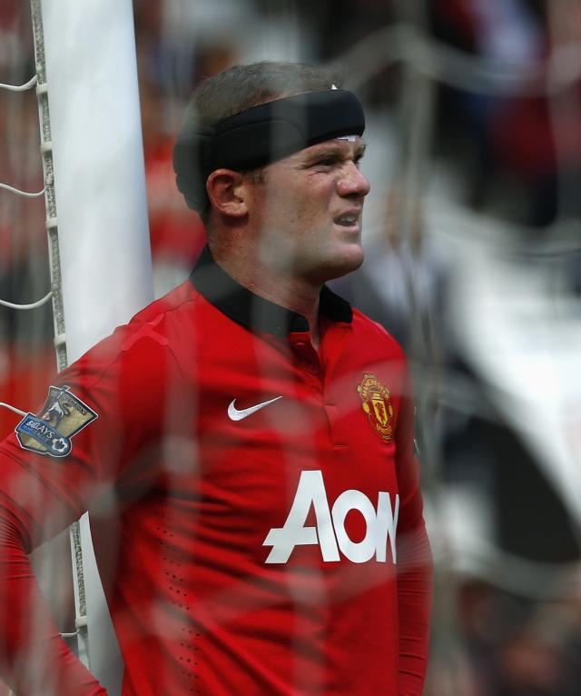 """Manchester United's Wayne Rooney reacts during their English Premier League soccer match against Crystal Palace at Old Trafford in Manchester, northern England September 14, 2013. REUTERS/Darren Staples (BRITAIN - Tags: SPORT SOCCER) FOR EDITORIAL USE ONLY. NOT FOR SALE FOR MARKETING OR ADVERTISING CAMPAIGNS. NO USE WITH UNAUTHORIZED AUDIO, VIDEO, DATA, FIXTURE LISTS, CLUB/LEAGUE LOGOS OR """"LIVE"""" SERVICES. ONLINE IN-MATCH USE LIMITED TO 45 IMAGES, NO VIDEO EMULATION. NO USE IN BETTING, GAMES OR SINGLE CLUB/LEAGUE/PLAYER PUBLICATIONS"""