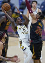 Indiana Pacers' Edmond Sumner (5) shoots over Cleveland Cavaliers' Isaac Okoro (35) during the second half of an NBA basketball game Wednesday, March 3, 2021, in Cleveland. (AP Photo/Tony Dejak)