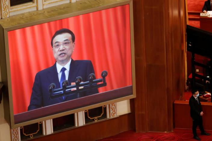 Chinese Premier Li Keqiang delivers a speech at the opening session of NPC in Beijing