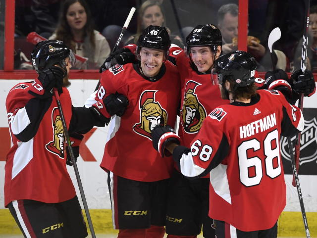 Ottawa Senators' Ryan Dzingel (18) celebrates his goal against the Buffalo Sabres with Fredrik Claesson (33), Matt Duchene (95), and Mike Hoffman (68) during second period NHL hockey action in Ottawa, Thursday, March 8, 2018. (Justin Tang/The Canadian Press via AP)