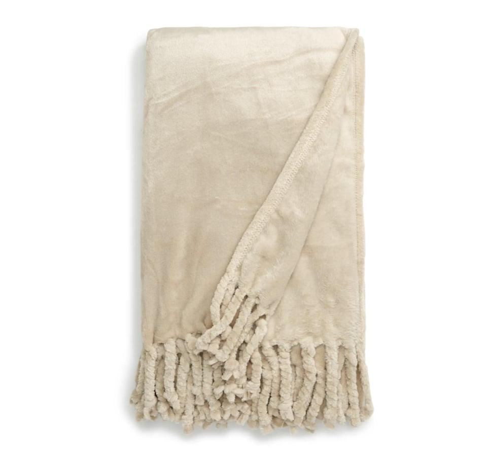 <p>This customer-favorite <span>Nordstrom at Home Kennebunk Bliss Plush Throw</span> ($40) comes in so many pretty colors.</p>
