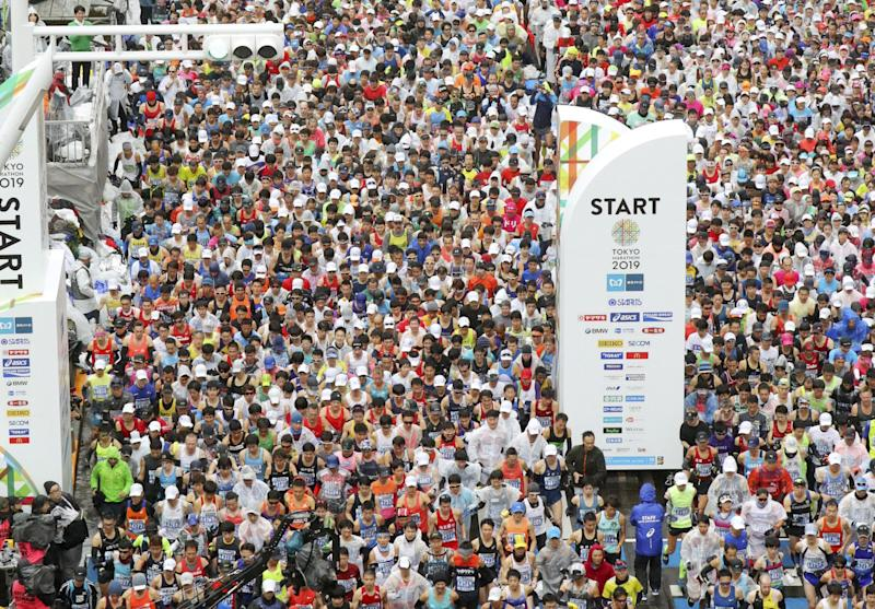 Athletics - Tokyo Marathon 2019 - Tokyo, Japan - 03/03/19 - Runners at the start of the Tokyo Marathon 2019, in this photo taken by Kyodo. Mandatory credit Kyodo via REUTERS ATTENTION EDITORS - THIS IMAGE WAS PROVIDED BY A THIRD PARTY. MANDATORY CREDIT. JAPAN OUT. NO COMMERCIAL OR EDITORIAL SALES IN JAPAN. THIS IMAGE WAS PROCESSED BY REUTERS TO ENHANCE QUALITY, AN UNPROCESSED VERSION HAS BEEN PROVIDED SEPARATELY.