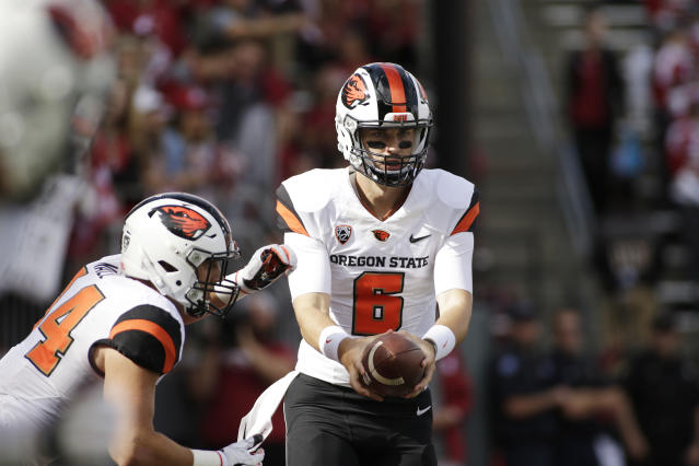 Oregon State quarterback Jake Luton (6) hands the ball off to running back Ryan Nall during the first half of an NCAA college football game in Pullman, Wash., Saturday, Sept. 16, 2017. (AP Photo/Young Kwak)