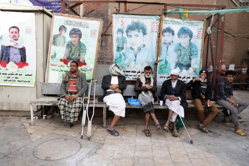 People sit at market cafe in Sanaa