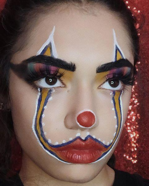 """<p>This look follows the same design idea of the creepy Pennywise makeup, but instead of using black and red shades, <strong>this look features cuter colors</strong>, like yellow, green, and pink. Don't forget the <a href=""""https://go.redirectingat.com?id=74968X1596630&url=https%3A%2F%2Fwww.sephora.com%2Fproduct%2Ffaux-mink-lash-collection-P404829&sref=https%3A%2F%2Fwww.cosmopolitan.com%2Fstyle-beauty%2Fbeauty%2Fg33247158%2Fcute-clown-halloween-makeup-tutorials%2F"""" rel=""""nofollow noopener"""" target=""""_blank"""" data-ylk=""""slk:false eyelashes"""" class=""""link rapid-noclick-resp"""">false eyelashes</a> to make it extra cute.</p><p><a href=""""https://www.instagram.com/p/B2UrMecnN72/?utm_source=ig_embed&utm_campaign=loading"""" rel=""""nofollow noopener"""" target=""""_blank"""" data-ylk=""""slk:See the original post on Instagram"""" class=""""link rapid-noclick-resp"""">See the original post on Instagram</a></p>"""
