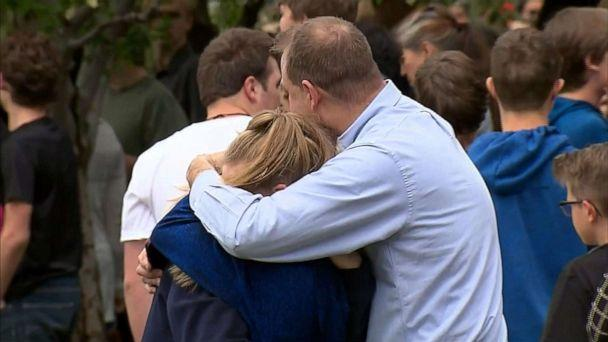 PHOTO: People hug at a meetup area after reports of a shooting at STEM School Highlands Ranch in Highlands Ranch, Colo., May 7, 2019. (KCNC)