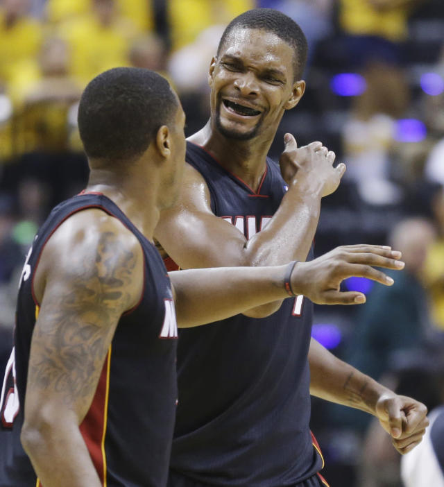 Miami Heat guard Mario Chalmers, left, and center Chris Bosh celebrate during the second half against the Indiana Pacers in Game 5 of the NBA basketball Eastern Conference finals in Indianapolis, Wednesday, May 28, 2014. (AP Photo/Michael Conroy)