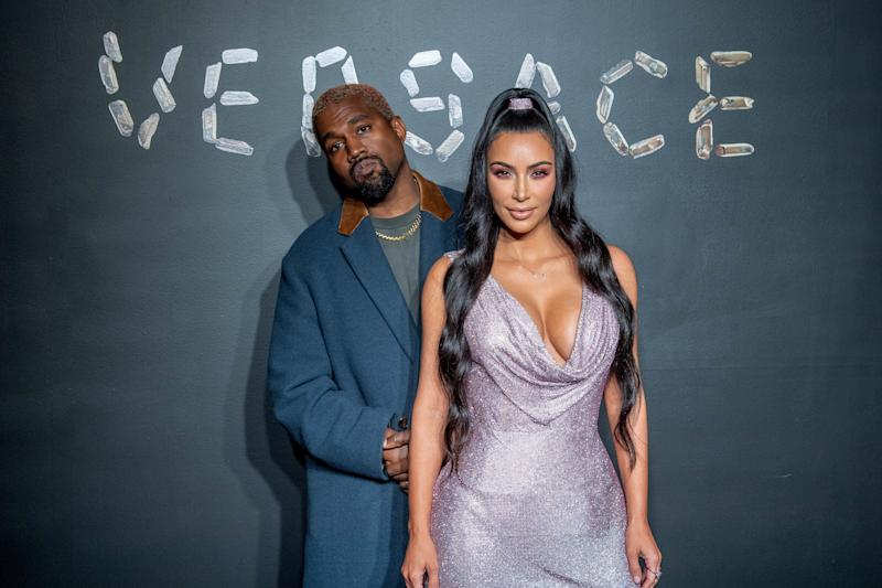 Kanye West and Kim Kardashian West attend the Versace fall 2019 fashion show on December 02, 2018 in New York City. (Photo: Roy Rochlin/Getty Images)